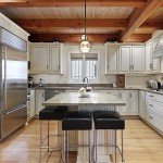 Renovated kitchen with white cabinets and granite tops